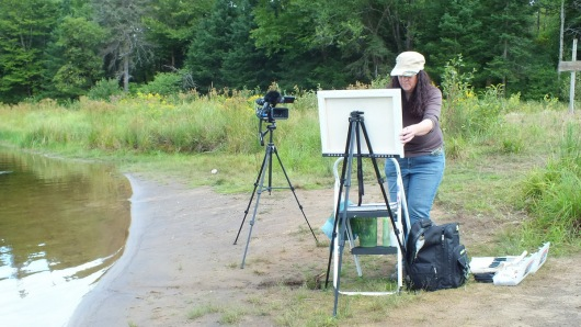 Janine Marson painting on the Oxtongue River